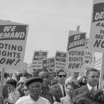 """What did people risk trying to get voting rights?"""